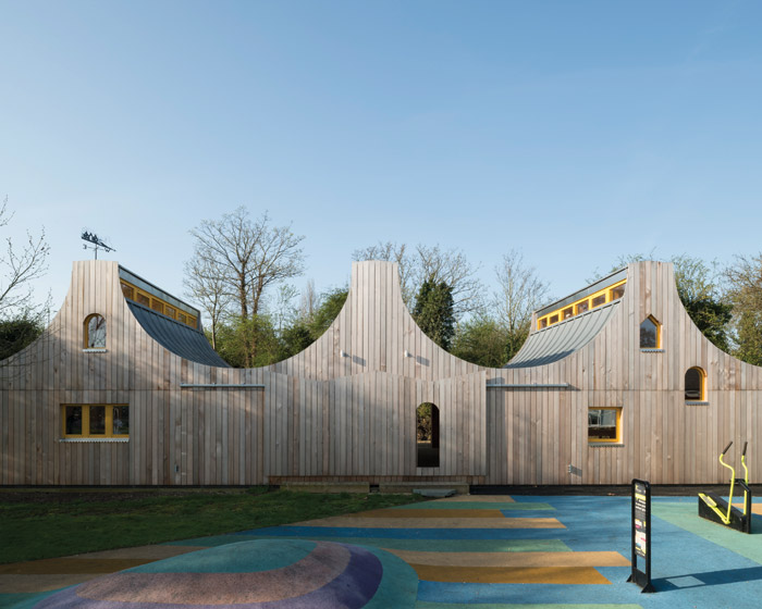 The new building is of three connected yet separate spaces, clad in timber to reference the nearby woodland