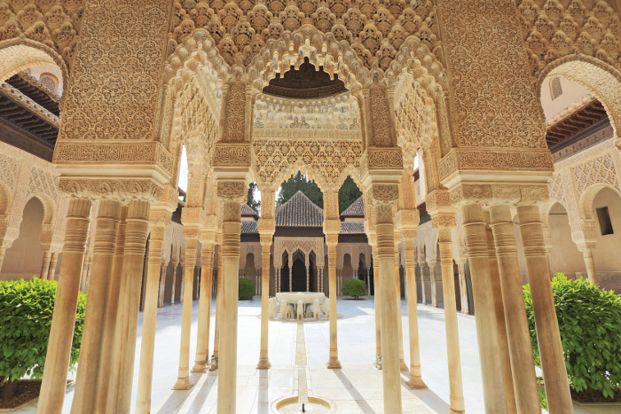 At the Court of the Lions, Alhambra, the architects converted the harsh desert sun into soft interior light by reflecting it twice: once off the white external paving and then off the butter-coloured stucco ceiling