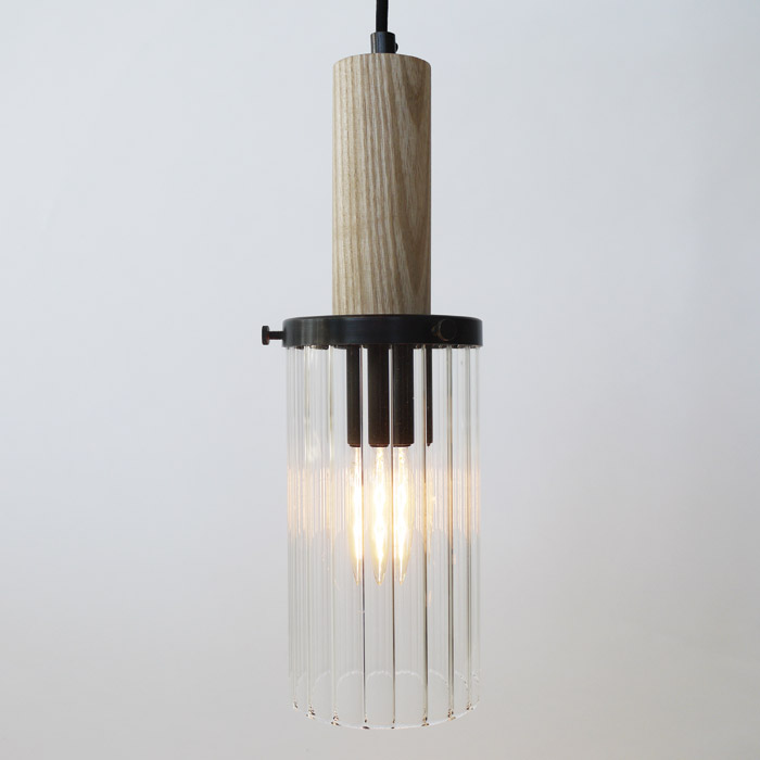 Wharf Lighting Collection: Consisting of pendant, table, desk, wall, ceiling and floor lights, the starting point for the collection came from experimenting with light through different types of glass. Reeded glass tubes provided a very interesting effect and the semi-transparent nature allows for an attractive LED 'filamentlook' bulb to be used.