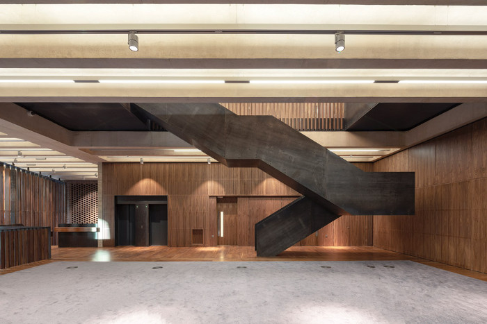 Grand waxed steel staircases wind through the floors of the building