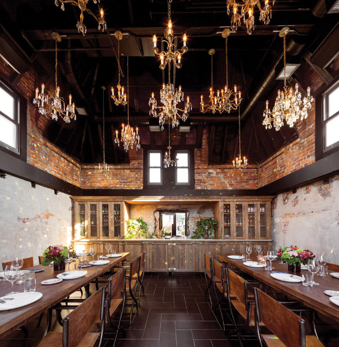 The private dining space in the turret features a 'symphony of chandeliers'