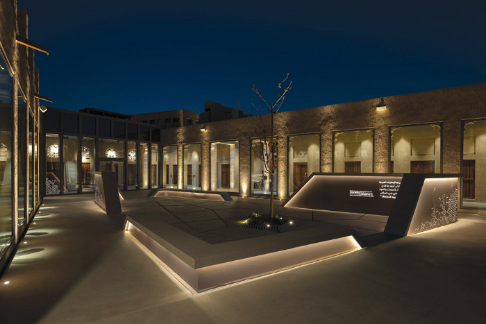 DPA employed uplighting on the vertical surfaces in the courtyard. Image credit: ALEX JEFFRIES PHOTOGRAPHY GROUP.