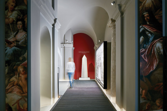 The red wall features a quote from Sir Christopher Wren that states 'architecture aims at eternity'