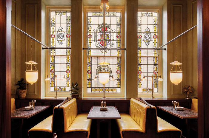 The yellow-tinted stained glass windows allow a lovely quality of light into the room