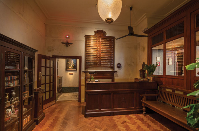 A teak 'in/out board' from a Bombay hospital takes pride of place in the lobby