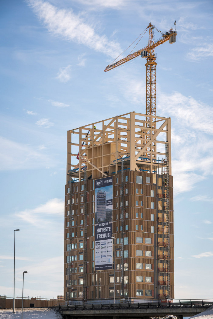 Mjøstårnet in Brumunddal, Norway, which was completed in March 2019, now holds the title of the world's tallest all-timber building, with even its lift shafts being made from CLT. It is 85.4m high and has 18 storeys, mainly apartments with some retail and office space. All the timber was sourced locally. Architect: Voll Arkitekter. Client: AB Invest. Timber structure: Moelven Limitre. Image credit: Moelven.