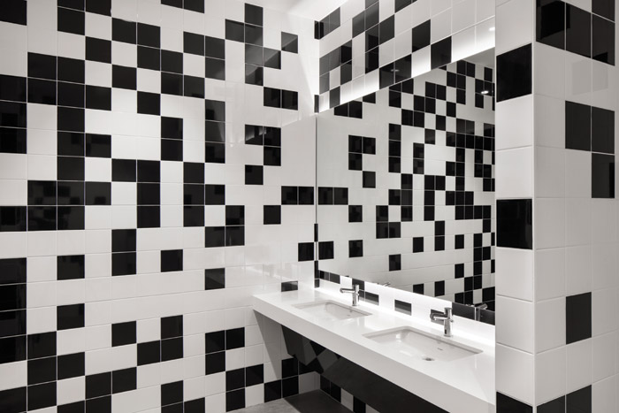 Note the intended similarity between the tiles in OCAD U CO's bathrooms and the Sharp Centre for Design facade