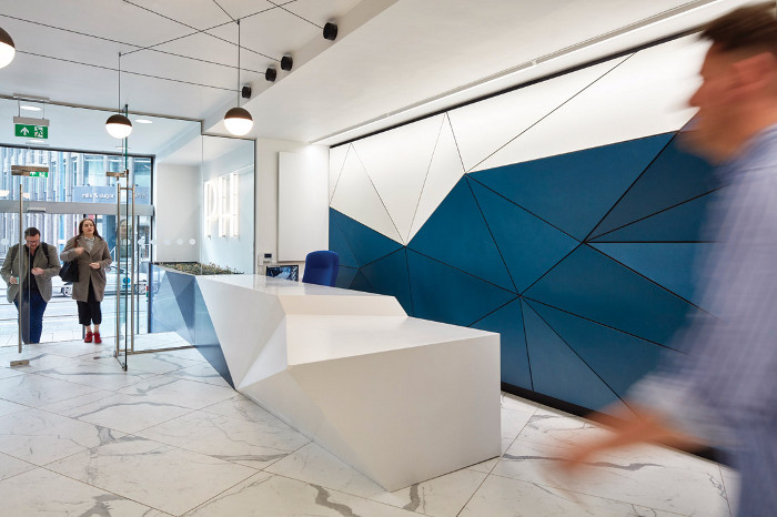 The existing reception desk was clad with Hi-macs, echoing the shapes of the joinery. The desk appears to flow seamlessly through the front glazing, becoming a flowerbed outside