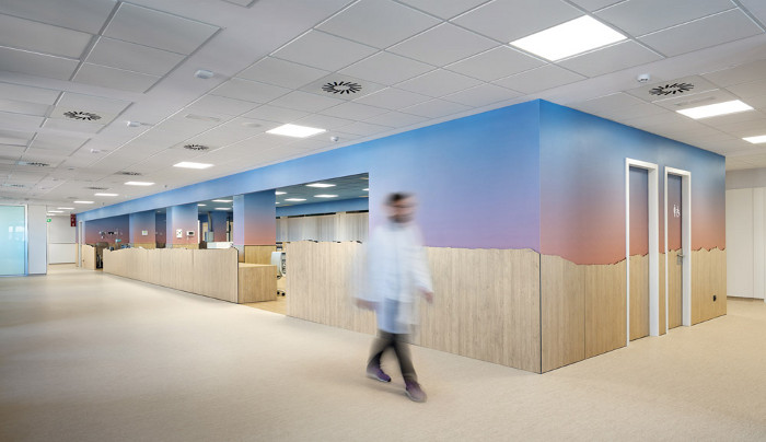 The blue and pink walls suggest a sunset, bringing the natural world into the hospital setting