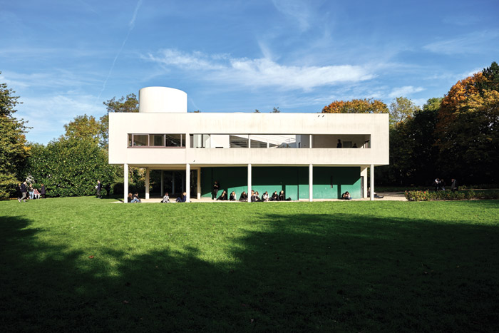 Located just outside Paris, the Villa Savoye 'refined the principles of modernism in a single and beautiful building'. Image Credit: August Fischer