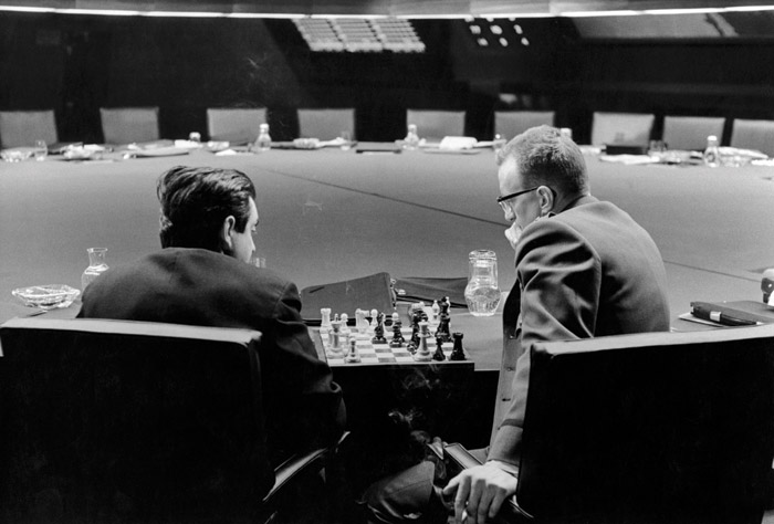 Kubrick (left) and actor George C. Scott play chess in the war room during a break in the filming of Dr. Strangelove