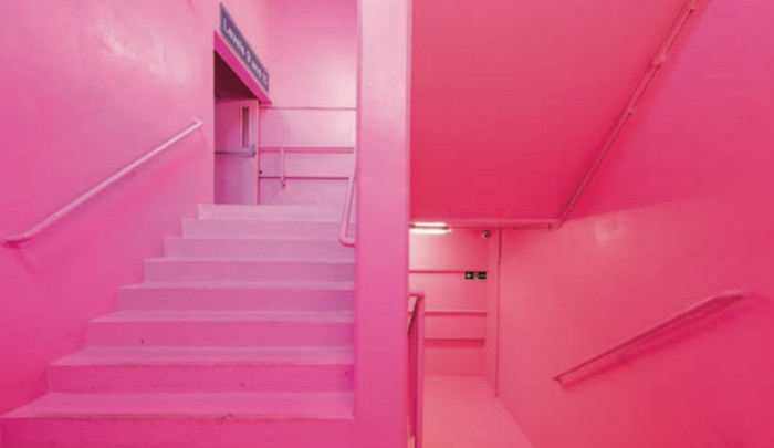 The bubblegum pink walls, ceilings, floors, railings, pipework and doorways is an artwork called hi boo i love you by Simon Whybray. Image Credit: DAMIAN GRIFFITHS