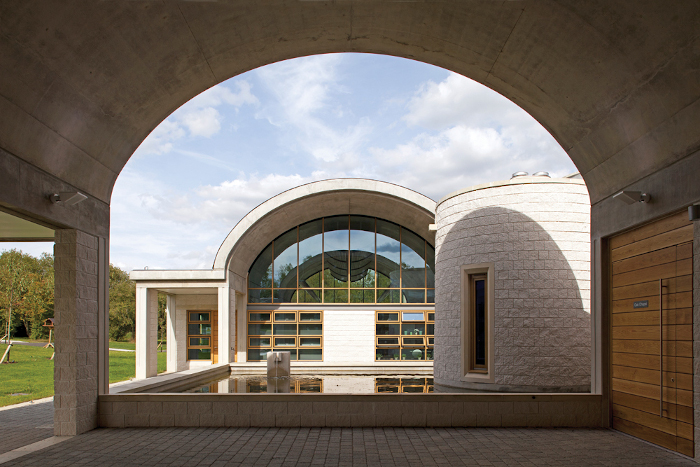 Oak Chapel in Crownhill, Milton Keynes, has curved arches, tranquil pools and flowing water to capture the peace and tranquillity found in Moorish architecture such as the Alhambra. The emotional needs of visitors were paramount in the design brief, with the tiny sanctuary chapel – with views over the water and walls made out of dense concrete masonry incorporating sparkling white Dolomite stone – offering an intimate setting for small funerals as well as a place to withdraw for those overcome by emotion. Architect: Adrian Morrow, in collaboration with Toby Maloy, Paul Hutchinson and Louisa Wan, MK Architects. Client: Phil Winsor, Chris Londy and Angela Abbott, Milton Keynes Council. Quantity Surveyor: Pick Everard. Structural engineer: Price + Myers. Glass artist: Julian Stocks. Image credit: David Thrower, Redshift Photography.