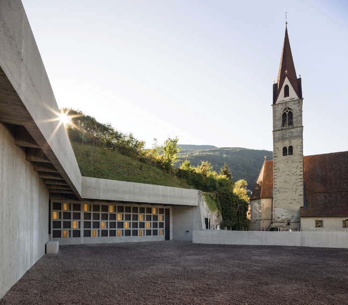 The contemporary extension to the Albes cemetery in Italy, completed in 2018, merges the old and new into a tranquil space where silence can be comfortably experienced, whether it's on the terrace overlooking the views or under the skylight with its changing patterns of light and shadow. Architect: Stefano Peluso Architecture. Client: Municipality of Bressanone. Engineering: Maurizio Staglianò. Lighting consultants: Büro Von Lutz. Image credit: Gian Paolo Guacci.