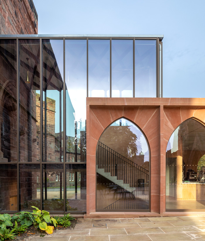 The fully glazed bronze linking structure between the Fratry, undercroft and cafe