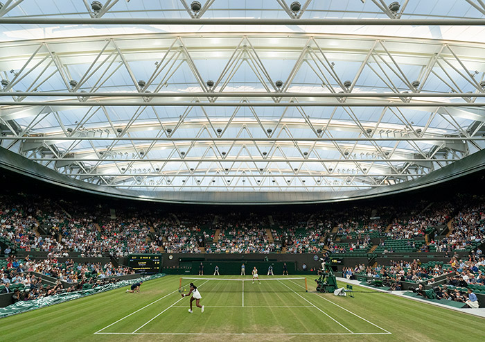 As prone to the vagaries of the weather as anywhere else, Wimbledon was slow to respond with proposals to put roofs over its main courts. Image Credit: AELTC/Bob Martin