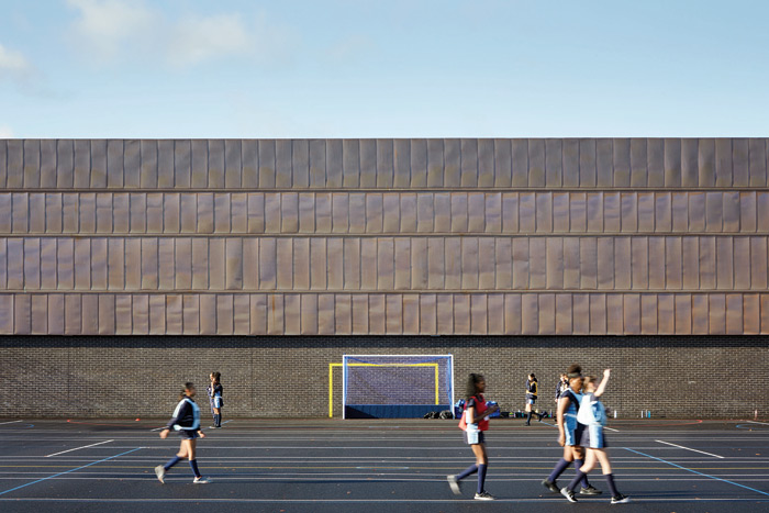 The sports hall's copper cladding
