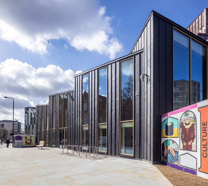 From the outside, the low-level building is clad in zinc. Image Credit: John Sturrock