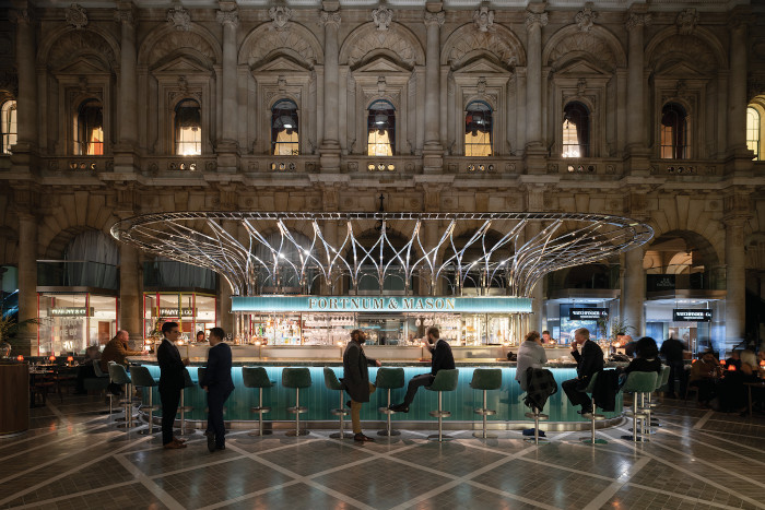 Fortnum & Mason's bar/restaurant at London's The Royal Exchange. Speirs + Major says the light sources allow the food, drinks and faces to appear naturally vibrant and appealing