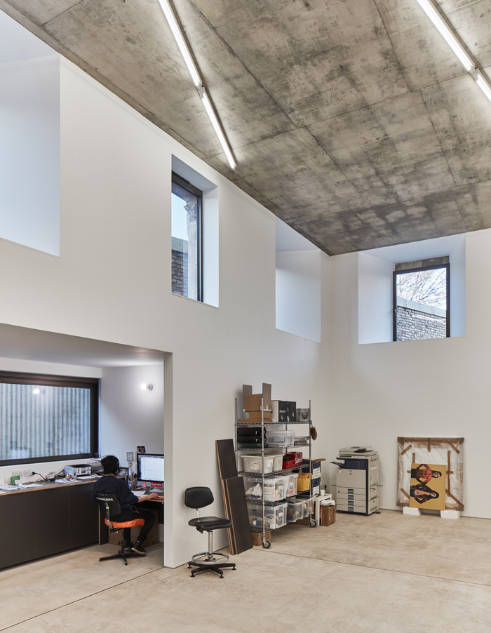 An open-plan, double-height space serves as Webster's studio