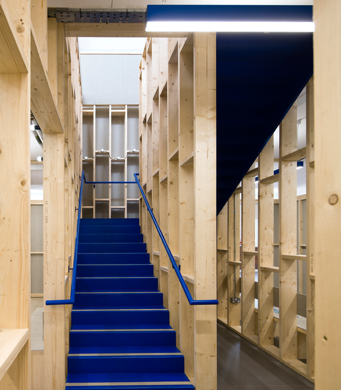 The blue shade flags up the staircases and circulation elements