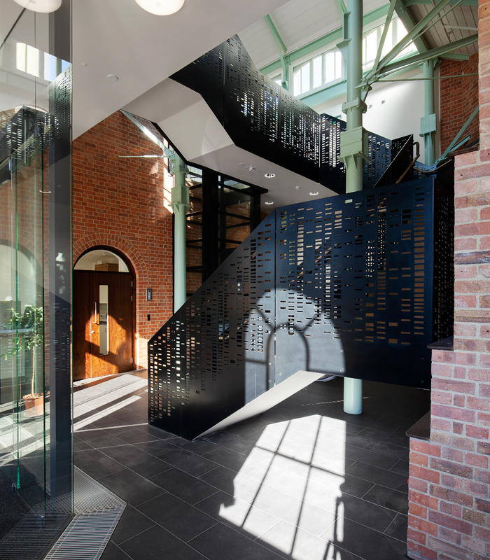 Large, arched windows bring in abundant light to office and lab spaces