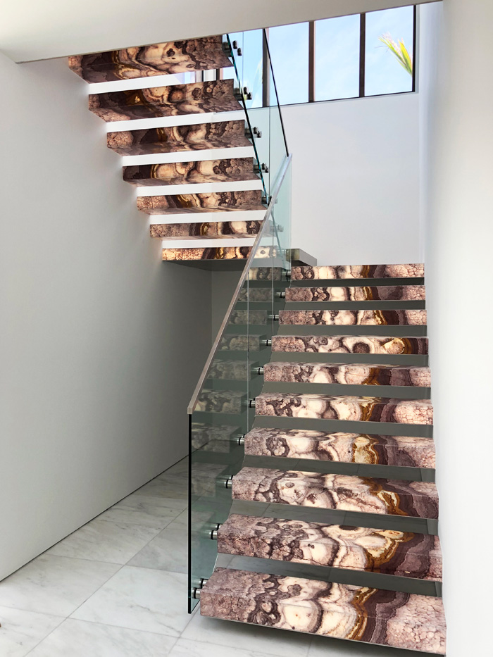 It was its affinity with light that drove the decision to use smoky purple onyx on this staircase