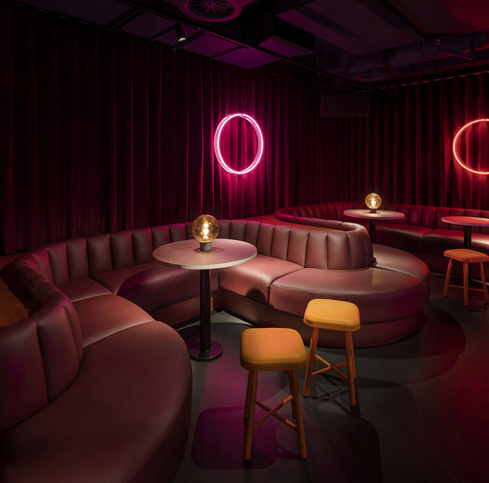 Neon circles provide low-level lighting in the subterranean Supermax