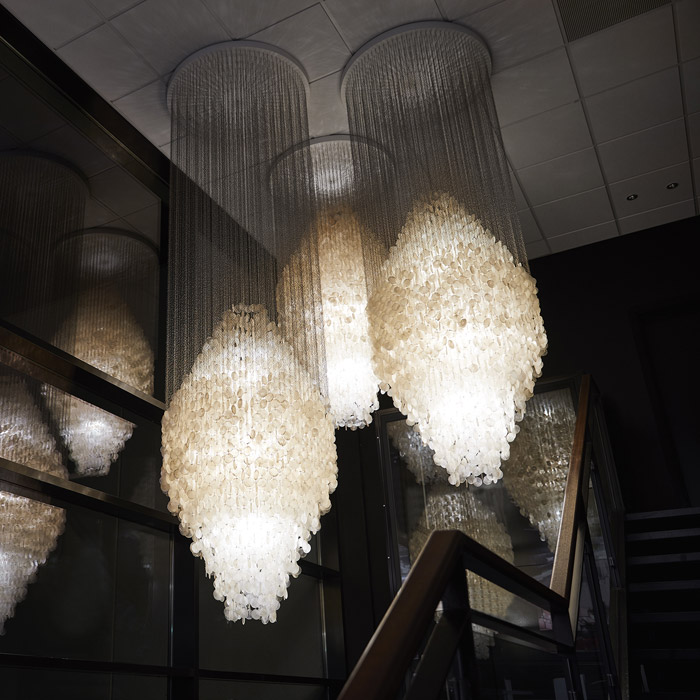 The Fun lamps feature hand-cut mother-of-pearl discs
