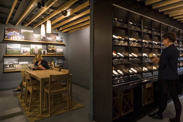 Berry Bros & Rudd's warehouse shop in Basingstoke maintains its signature aesthetic of wood furnishings and lit bottles. Image Credit: Chris Horwood