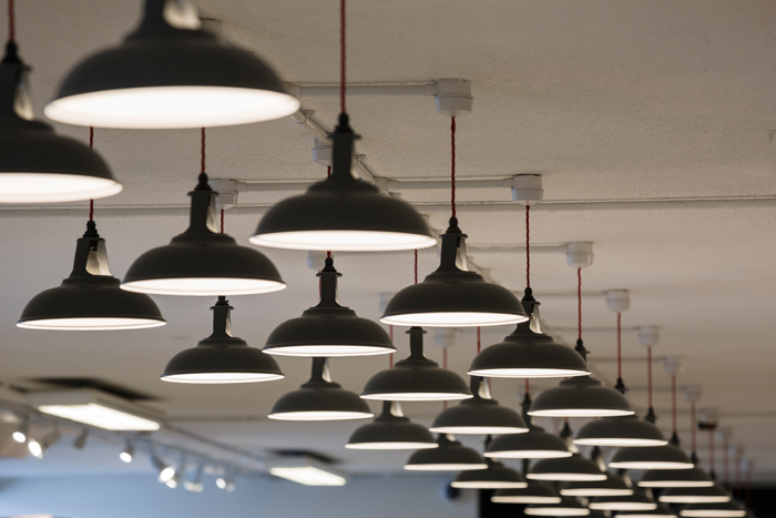 Lighting in the warehouse, an example of Mowat & Company's seamless amalgamation of old and new styles. Image Credit: Chris Horwood