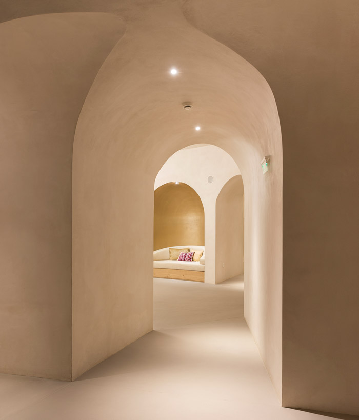 The communal rooms and corridors of the Euphoria Retreat take design cues from Byzantine archways and contemporary lighting, with a focus on low-contrast illumination. Image Credit: Margarita Nikitaki