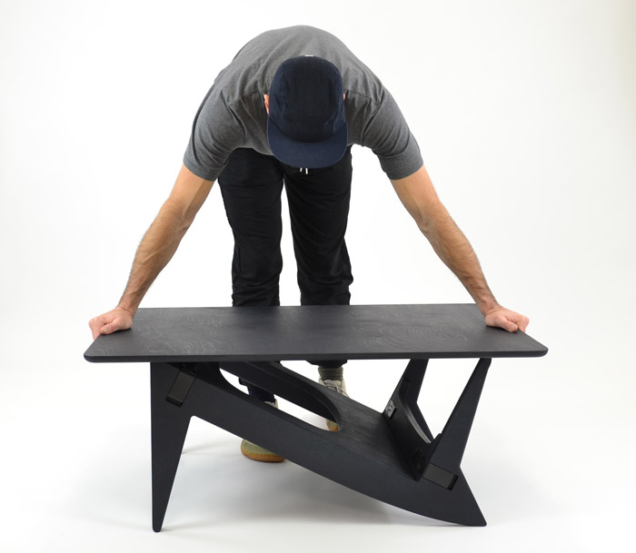 Rotable's base can be flipped to transform it from a desk or dining table into a coff ee table.