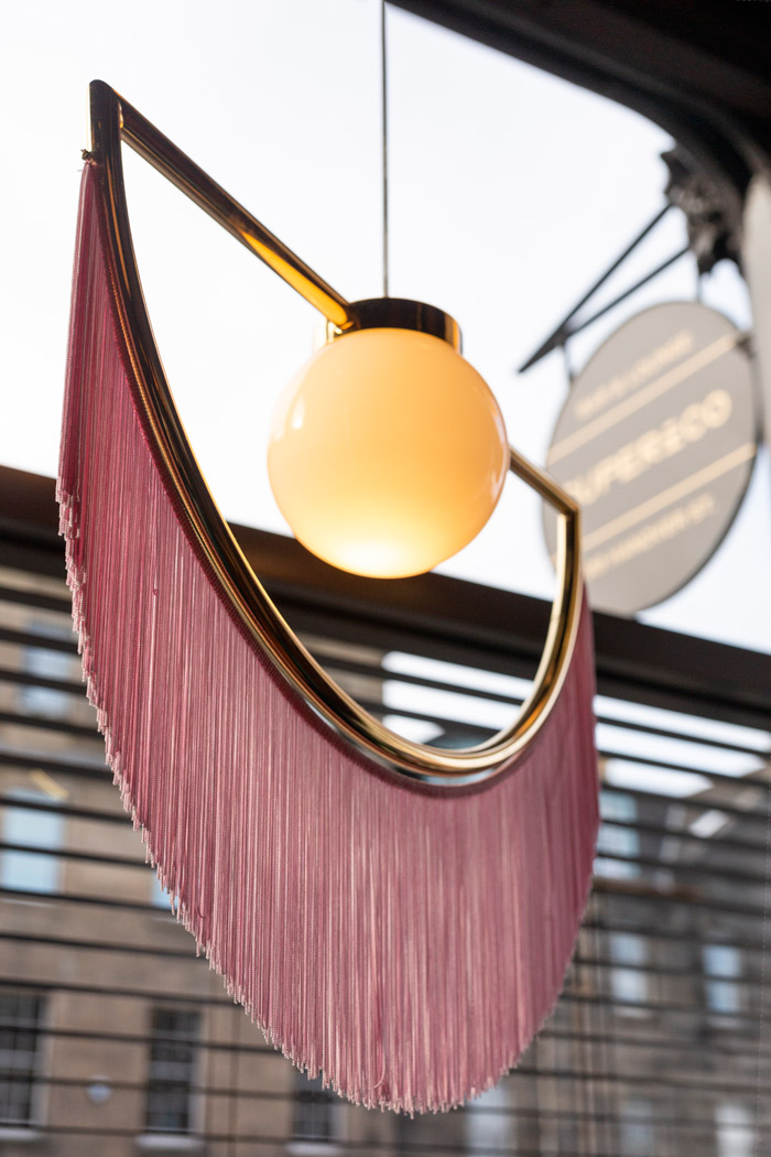 Wink lights by Masquespacio, and the table-embedded wiggle lines that Jaco Justice took from his South American travels