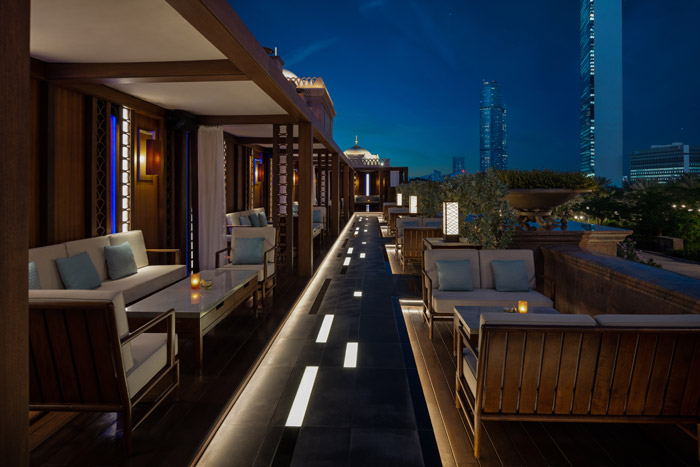 Hakkasan Terrace's distinctive blue lighting, by Nulty+, is housed in a small, vertical reveal at the back of The Cabanas Hotel in Abu Dhabi, adding to the ambience while reinforcing Hakkasan's identity. Image Credit: Alex Jeffries