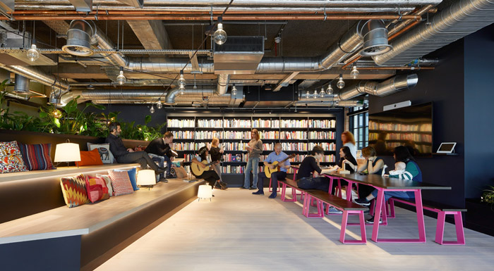 So much care went into the design – here, innovative communal seating and a library – that tp bennett is working on other OSF offices around the world