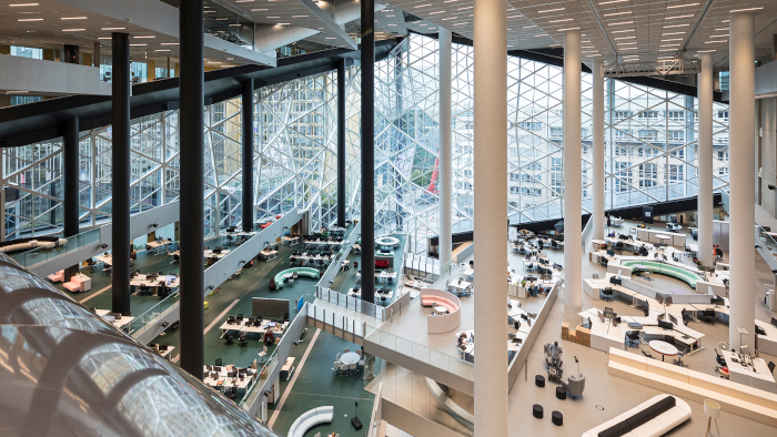 The vast newsroom atrium, with multiple levels, regions and open plan zones, connected by an intricate lattice of walkways and bridges. Image Credit: LAURIAN GHINITOIU