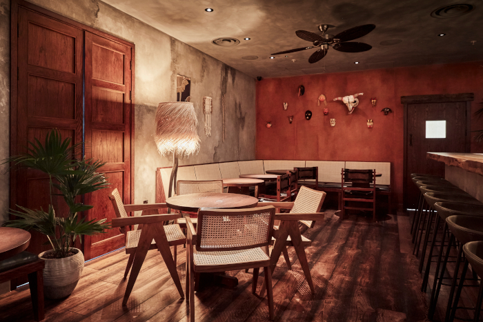 the stucco walls dovetail sweetly with the reclaimed wooden floors and seagrass lampshades
