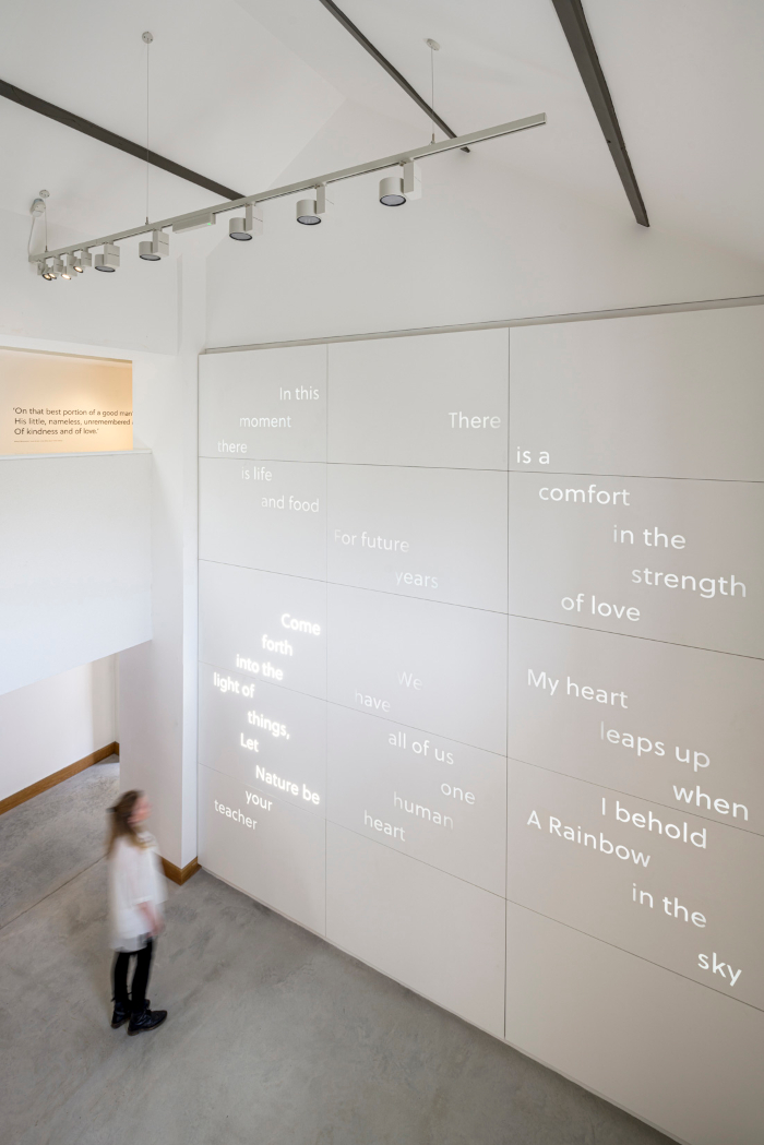 Visitors are welcomed into the museum space by an illuminated wall of quotations from Wordsworth's work