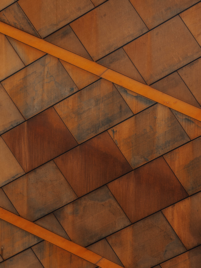 Close-up on Mole Architects' CorTen steel-covered C2 building. Image Credit: DESIGN DISTRICT