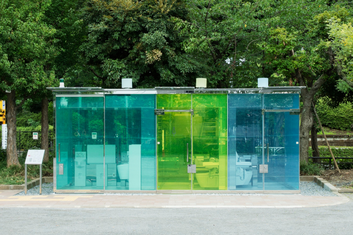 Shigeru Ban's Haru-No- Ogawa Community Park, another of the Tokyo Toilet Project designs. It uses glass technology that turns the walls from transparent to opaque when locked, and shines like a multi-coloured lantern at night; the clear walls take away fears about safety and cleanliness as the whole toilet can be clearly seen before entering Designer: Shigeru Ban Client: Nippon Foundation Sanitaryware: Toto Contractor: Daiwa House Industry