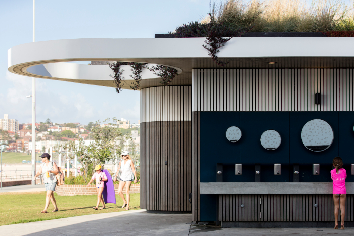 In Sydney, the North Bondi Beach toilets, changing rooms, showers and bus stop-seating facility, designed by Sam Crawford Architects. The local council's toilet-building programme ensures no one is ever further than 400m from the nearest loo. The building won the AIA National Architecture Award for Small Project Architecture in 2017 Architect: Sam Crawford Architects Client: Waverley Council Contractor: Grindley Interiors. Image Credit: BRETT BOARDMAN