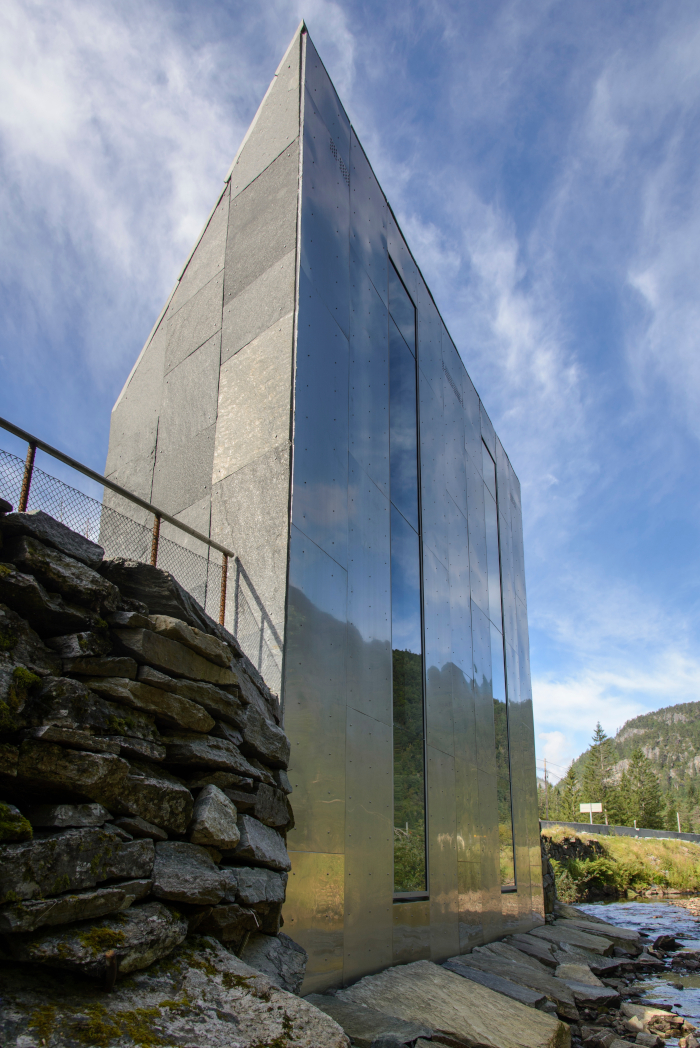 The bold Norwegian Scenic Routes WC facility at the Skjervsfossen waterfall. It has been designed to look like it was carved out of the mountain rock and relocated on to a river bank, with its pointed, rugged shape made from local stone. A glazed section of the cubicles allows views over the moving water below Architect: Fortunen Arkitektur Client: Norwegian Scenic Routes Landscape: Østengen & Bergo Landscape Architects. Image Credit: STEINAR SKAAR
