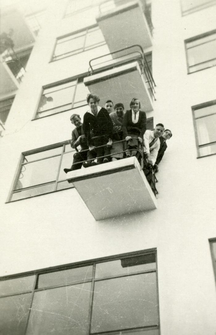 Bauhaus students on one of the Prellerhaus balconies, part of the Bauhaus Dessau complex