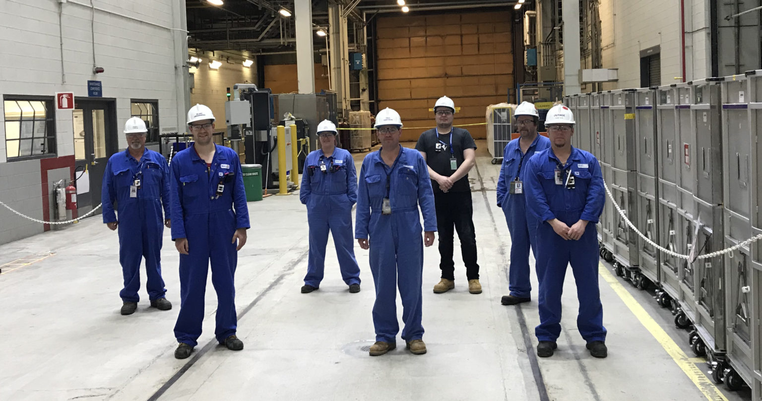 A crew at Bruce B pose for a photo with the final shipment of Cobalt-60 for the first half of 2020.