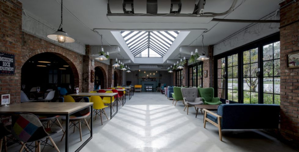 Exposed brick beams and vintage tiles create a unique retro vibe under the envelope of the original architecture wandering around expect