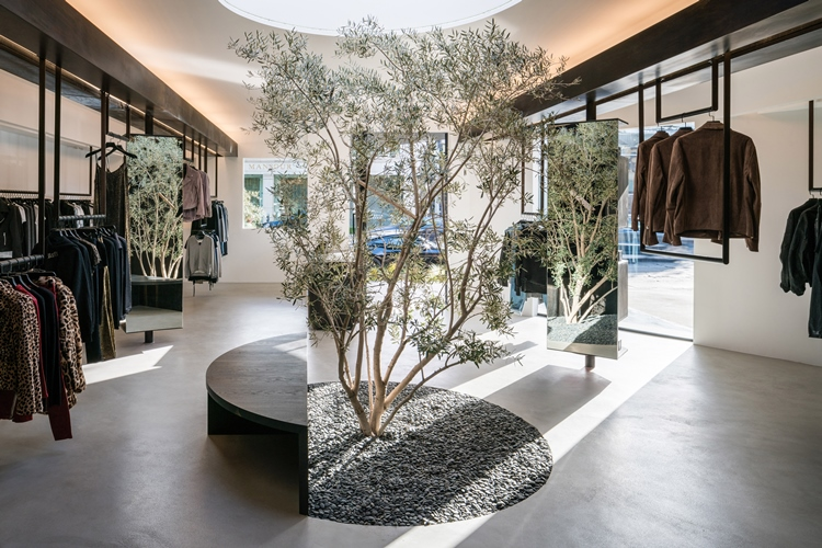 Road to awe opens flagship store on melrose avenue designcurial inside the 10 foot tall space this dream like vibe continues with a circular interior garden featuring an olive tree surrounded by grass and a circular malvernweather Images