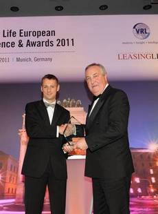 John Bennet, managing director of Hitachi Capital accepting the Leasing Life Life achievement award 2011 in Munich from Andrew Denton of CHP Consulting