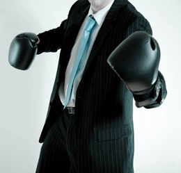 Photograph of business man with boxing gloves