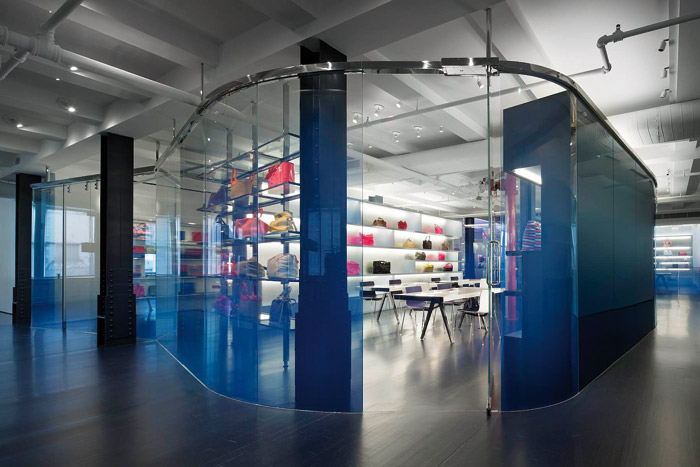 Metal halide highlights the trademark blue of Marc by Marc Jacobs used as a gradient frit of a meeting space. The opaque vibrant blue at the lower part of the partition adds to the illusion of privacy when seated. Photo: Scott Frances